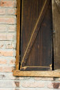 Rustic Wooden Shuttered Window From A Brick Stable Stock Photo - 32601610