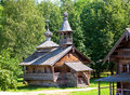 Wooden Church Against The Wood.Open-air Museum Of  Ancient Wooden Architecture. Russia. Vitoslavlitsy, Great  Novgorod. Royalty Free Stock Image - 32603326
