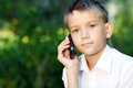 Boy Ten Years With Cell Phone Royalty Free Stock Photo - 32615705