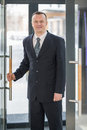 A Businessman Enters The Glass Door Stock Photo - 32655570