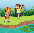A Monkey And A Tiger Playing Stock Photo - 32676580