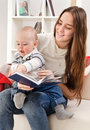 Young Mother Reads To The Child The Book Royalty Free Stock Photos - 32678498