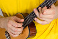Man Playing Ukulele Stock Photos - 32680593