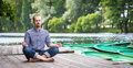 Young Handsome Man With Closed Eyes Sitting And Meditating Stock Photo - 32685760