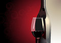 Glass Of Red Wine With A Bottle Stock Images - 32702204