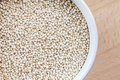 Raw Organic Quinoa Seeds In White Cup Stock Photography - 32702762