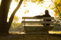 Senior Adult Male Sits Thoughtfully On Park Bench  Royalty Free Stock Images - 32704349