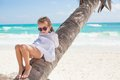 Little Cute Girl On Palm Tree At The Perfect Stock Photography - 32706712