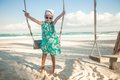 Adorable Little Girl In A Dress And Sunglasses On Royalty Free Stock Images - 32706989