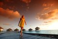 Woman In A Dress On Maldivian Sunset Royalty Free Stock Photography - 32734587