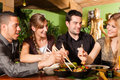 Young People Eating In Thai Restaurant Royalty Free Stock Photos - 32738668