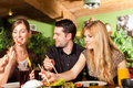 Young People Eating In Thai Restaurant Stock Photos - 32738683