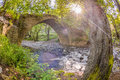 The Sun Shining Through The Trees At  Kelefos Bridge,cyprus,4 Royalty Free Stock Images - 32761479
