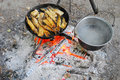 The Stake Is Fried Fish In A Frying Pan And Some Heated Pot Royalty Free Stock Image - 32767546