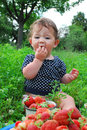 The Garden Beds Near The Little Girl Is Sitting, And Near It Is Royalty Free Stock Photography - 32767857