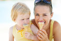 Mother And Baby Biting Ice Cream Stock Image - 32773941