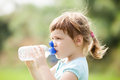Child Drinking From Plastic Bottle Royalty Free Stock Image - 32787986