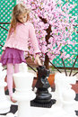 Girl Next To Artificial Cherry Blossom Touches Big Chess Pieces Royalty Free Stock Photography - 32793107