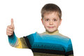 Young Boy Holds His Thumb Up Royalty Free Stock Image - 32803686