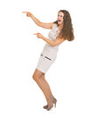 Full Length Portrait Of Happy Young Woman Pointing On Copy Space Stock Photography - 32827062