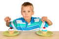 Boy And Two Cupcakes Stock Photos - 32840663
