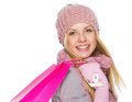 Happy Teenager Girl In Winter Hat And Scarf With Shopping Bag Royalty Free Stock Photography - 32844147
