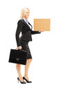 Full Length Portrait Of A Young Woman In Black Suit Holding A Pi Royalty Free Stock Photos - 32873878
