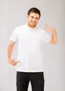 Man Pointing At Blank White T-shir Royalty Free Stock Image - 32886996