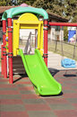 Green Slide And Blue Swing In The Park Stock Photography - 32889142