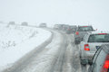 Traffic Jam In Heavy Snowfall On Mountain Road Royalty Free Stock Image - 32904216