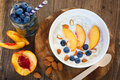 Granola With Fresh Organic Blueberries, Nectarines And Almonds Stock Image - 32909871