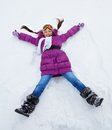 Girl Laying In Star Shape In Snow Stock Images - 32910964