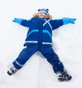 Little Boy Laying In Star Shape In Snow Stock Photography - 32911202