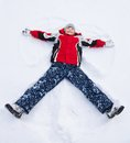 Boy Laying In Star Shape In Snow Royalty Free Stock Images - 32911269