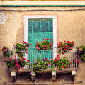 Beautiful Vintage Balcony With Colorful Flowers And Door Stock Photography - 32938572