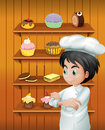A Chef In Front Of The Baked Goodies Royalty Free Stock Images - 32941409
