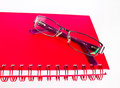 Notebook And Eyeglasses. Royalty Free Stock Image - 32949386