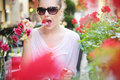 Delighted Brunette Lady Eating Sweet Strawberry Royalty Free Stock Photography - 32949577