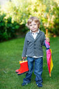 Little Cute Toddler Boy With Colorful Umbrella And Boots, Outdoo Stock Images - 32960624