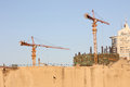 Cranes And Buildings Stock Images - 32961914