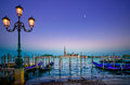 Venice, Street Lamp And Gondolas Or Gondole On Sunset And Church On Background. Italy Stock Photography - 32973702