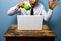 Clumsy Businessman Spilling Coffee On His Laptop Computer Royalty Free Stock Photos - 32979048