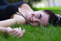 Brunette Lying On A Grass Royalty Free Stock Photography - 32999767