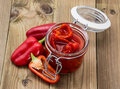 Glass With Pickled Paprikas Stock Photo - 33014660