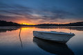 Boat In Lake With Sunset In Royal National Park, NSW Australia Royalty Free Stock Photography - 33024047
