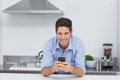 Man Typing On His Smartphone Stock Image - 33052181