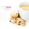 Oatmeal Cookie With Raisins And Cup Of Green Tea On  White Backg Royalty Free Stock Photography - 33055107
