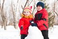 Boy And Girl Playing With Snow In Winter Park Royalty Free Stock Photography - 33072307
