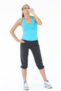Studio Shot Of Exercising Woman Drinking Water Royalty Free Stock Photography - 33074107