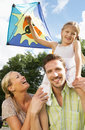Family Flying Kite In Countryside Royalty Free Stock Photography - 33076427